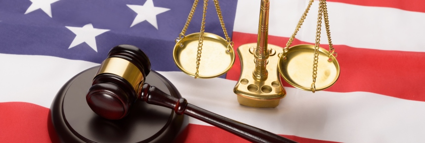 Justice scale, gavel, and US flag