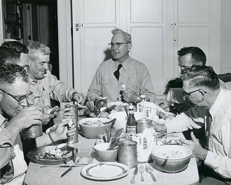 Men Eating at Table