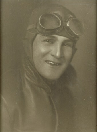 Russell H. Pearson wearing aviation goggles and cap