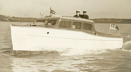 Ed Parker's Boat, Ray Wyatt and Skeet Haltom over cabin, February 1938