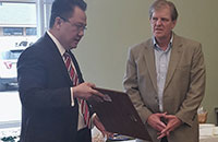 Commissioner Nguyen Presents Resolution to Bob Hart