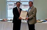 Bob Hart Accepts Plaque from Commissioner Nguyen