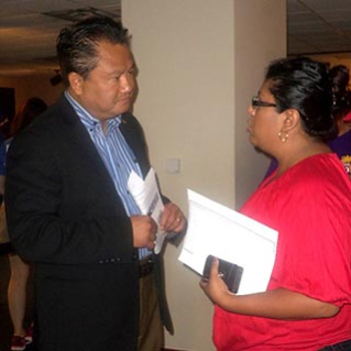 Commissioner Nguyen assists attendee