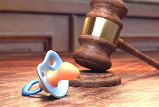 Gavel and baby pacifier