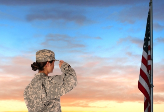 A woman in military uniform salute the flag