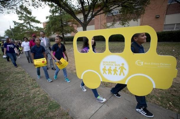 Children walking to their school on Walk to School Day at C.C. Moss Elementary